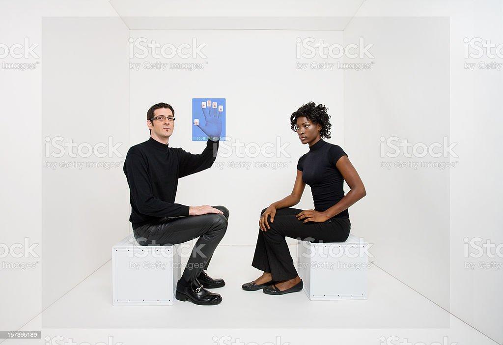 Woman watches man using virtual fingerprint scanner