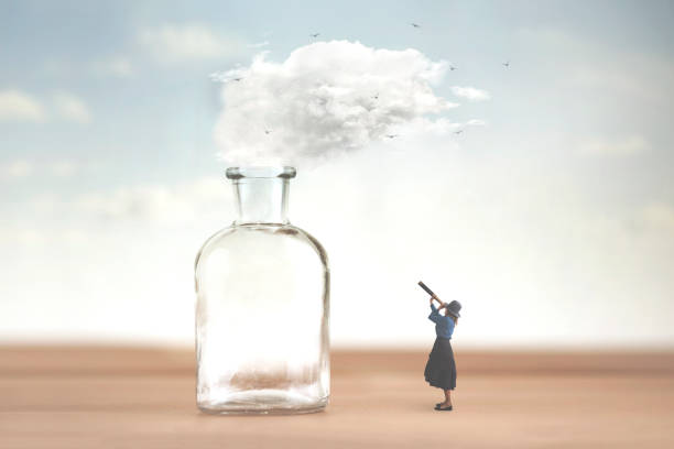 woman watches with telescope a cloud that is freed from a vase and escapes into the sky stock photo