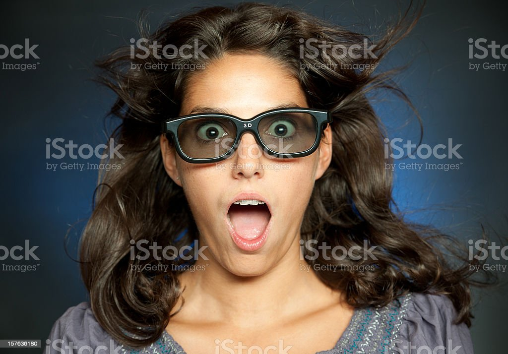 Woman watching 3-D Movies (XXXL) stock photo