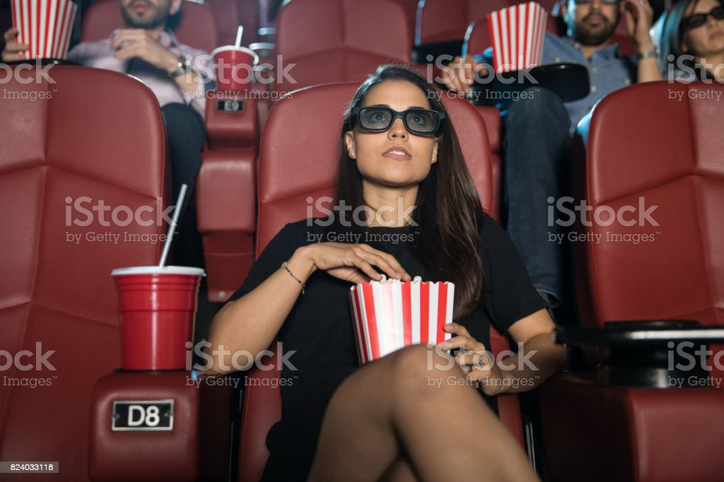 Woman watching a 3D film stock photo