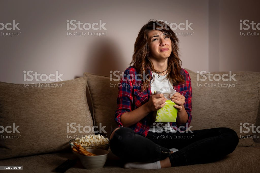 Woman watching a drama movie and sobbing stock photo
