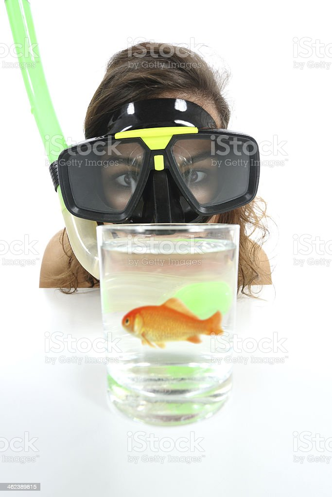 Woman watching a fish with holiday desires stock photo