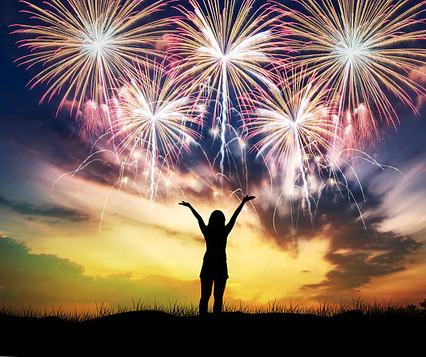 woman watching beautiful fireworks holiday. - new year day stock photos and pictures