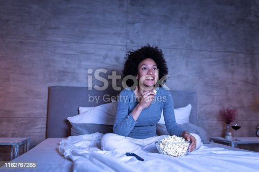 istock Woman watching comedy on TV 1162767265