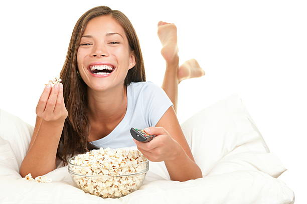 Woman watching funny movie laughing stock photo