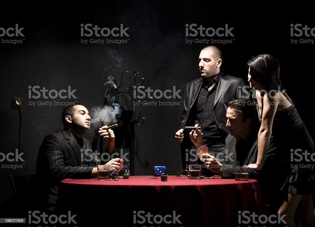 Woman Watching Group of Gangster Men Playing Poker stock photo