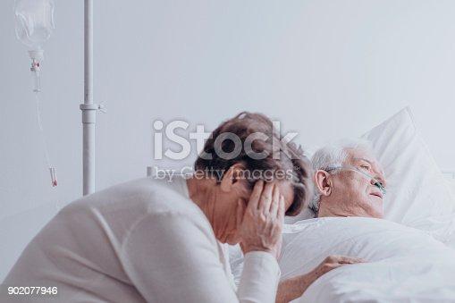 902077950istockphoto Woman watching his ill husband 902077946