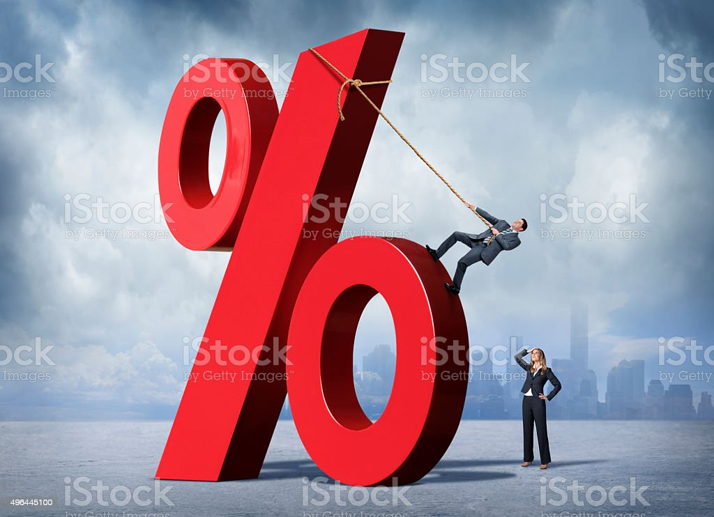 Woman Watching Man Scale Very Large Percentage Sign stock photo