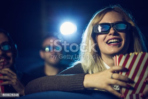 istock Woman watching movie in cinema 855628348