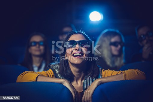 istock Woman watching movie in theater 838937880