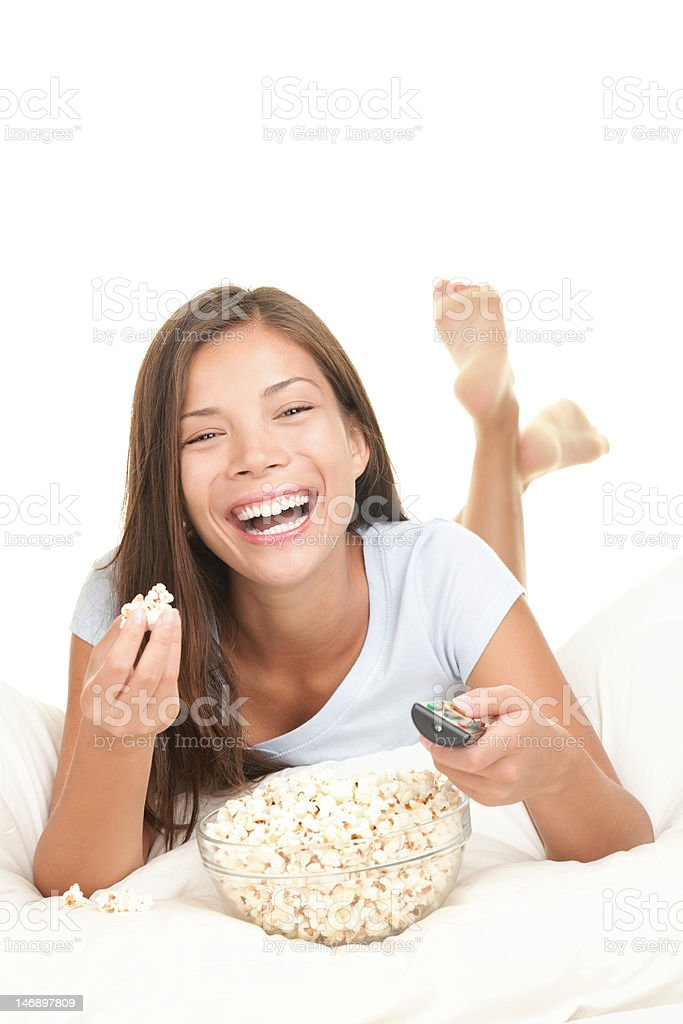 Woman watching movie laughing eating snack royalty-free stock photo