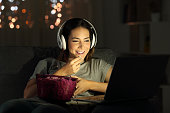 Woman watching online tv in the night