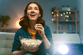 istock woman watching projector 1264639332
