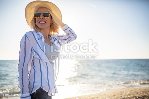 Woman at the beach watching sunset