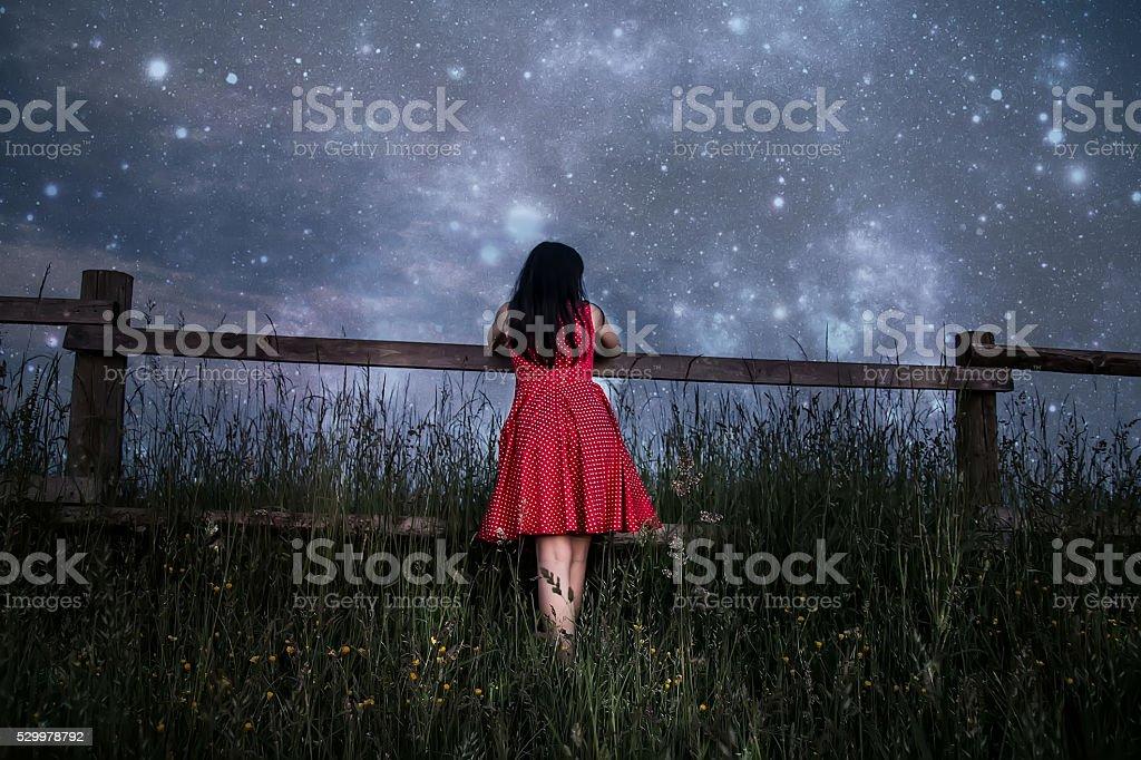Woman watching the stars stock photo