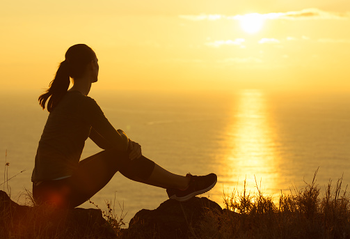 Woman watching the sunrise