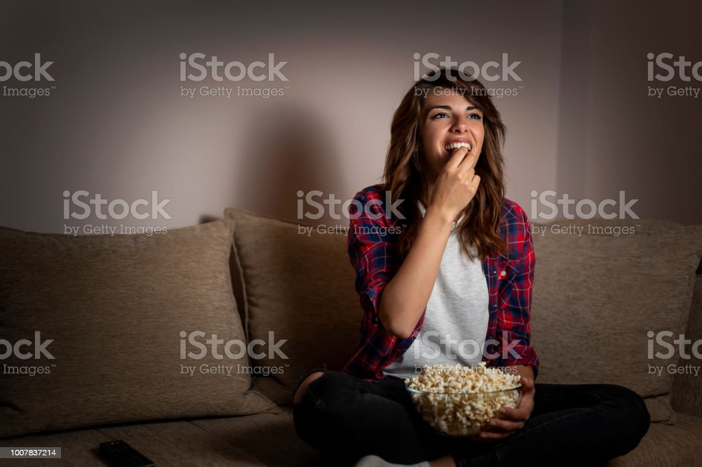 Woman watching TV stock photo