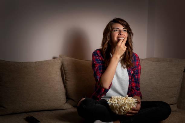 Woman watching TV stock photo