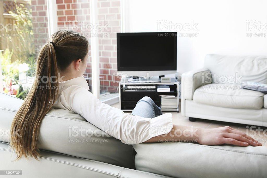 woman watching TV royalty-free stock photo