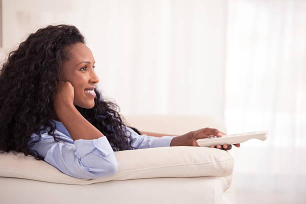 Woman watching TV. stock photo
