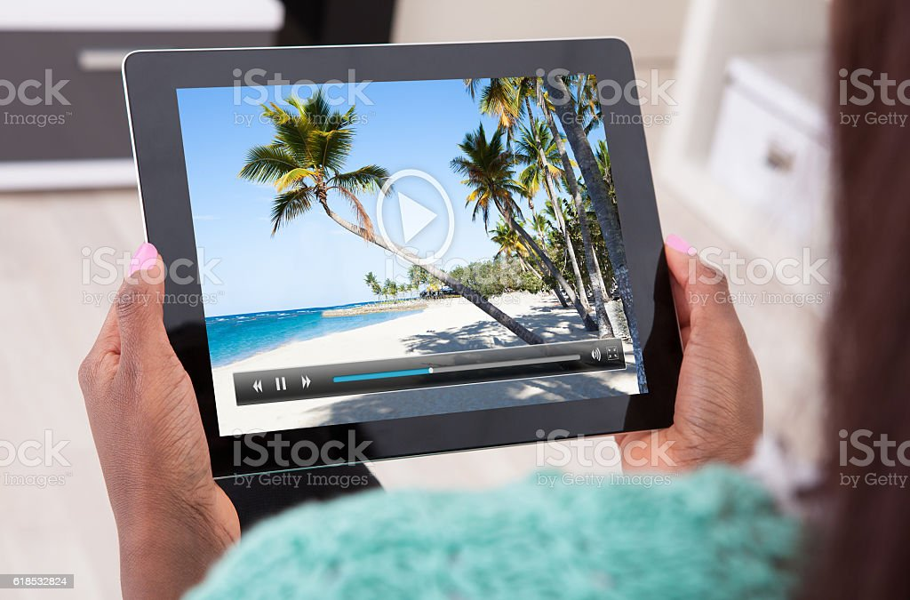 Woman Watching Video On Digital Tablet stock photo
