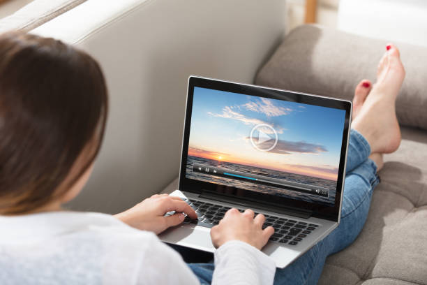 Woman Watching Video On Laptop stock photo