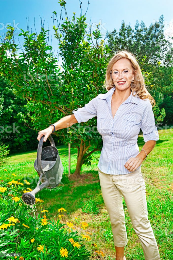 Woman watering flowers royalty-free stock photo