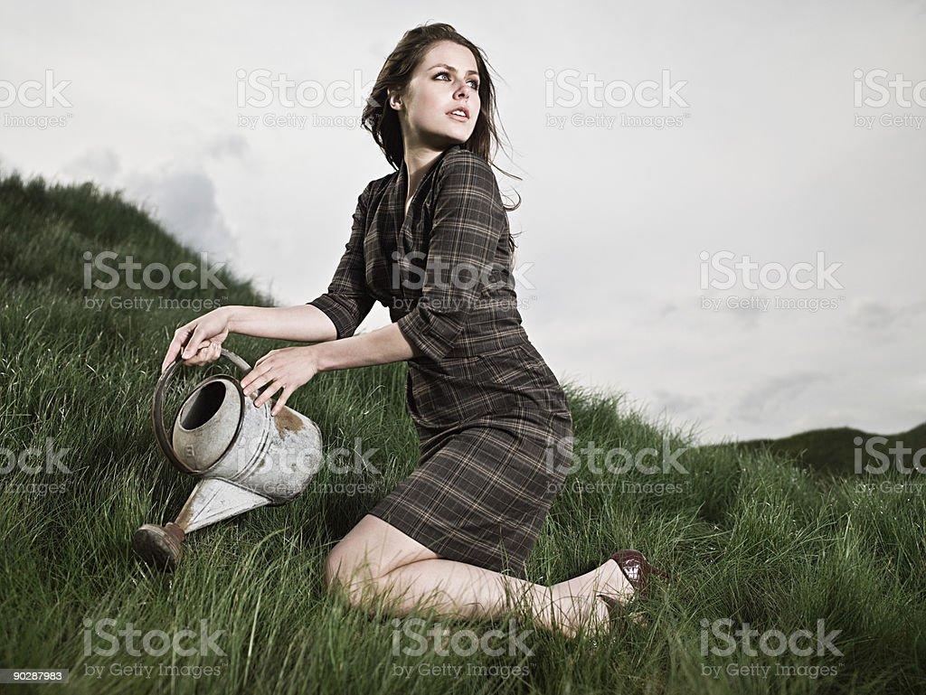 Woman watering grass stock photo