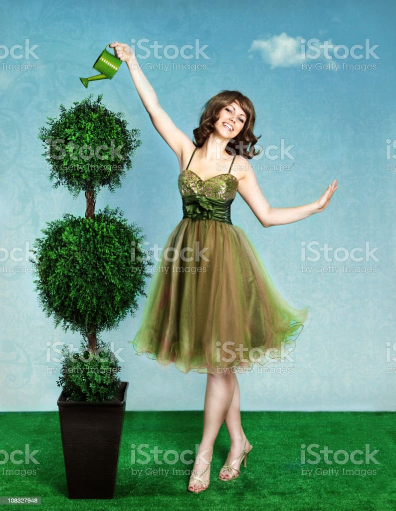 Woman watering tree royalty-free stock photo