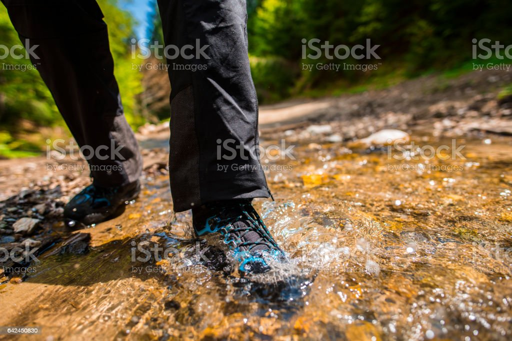 woman waterproof shoes in the river stock photo