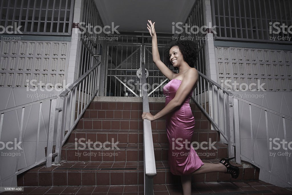 Woman waving and smiling stock photo