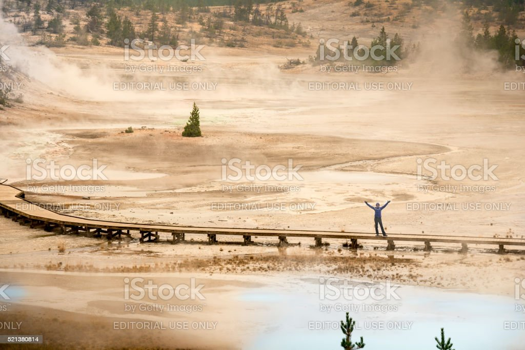 Woman waving from Norris Geyser Basin stock photo