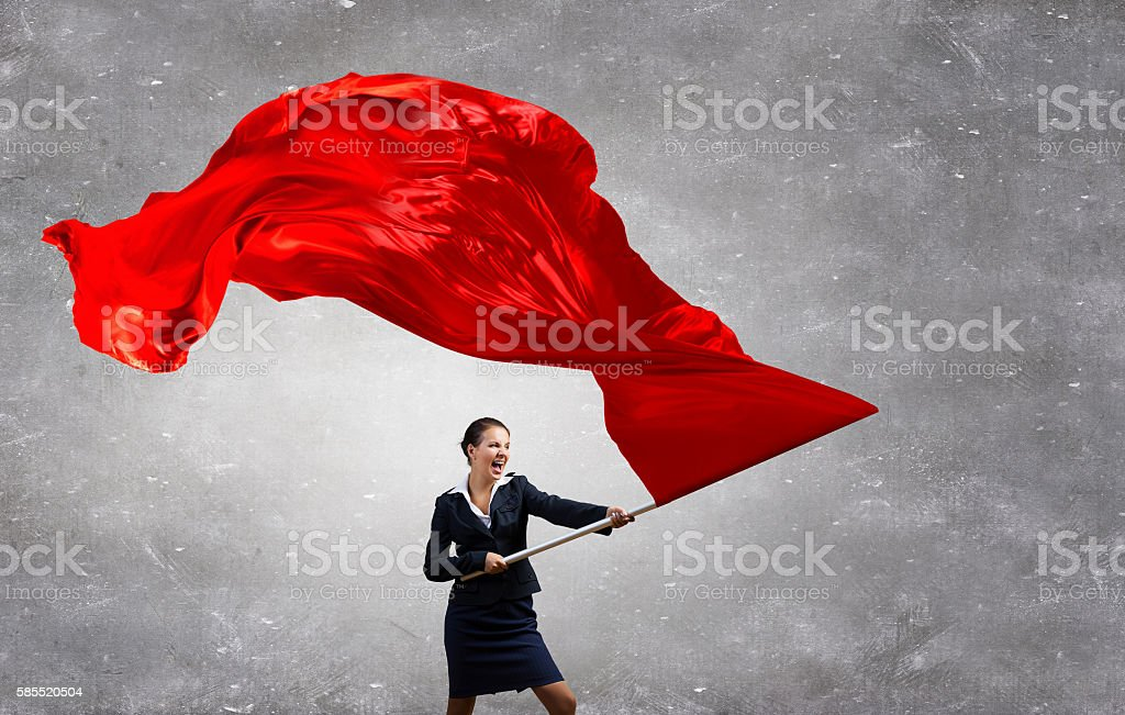 Woman waving red flag . Mixed media stock photo