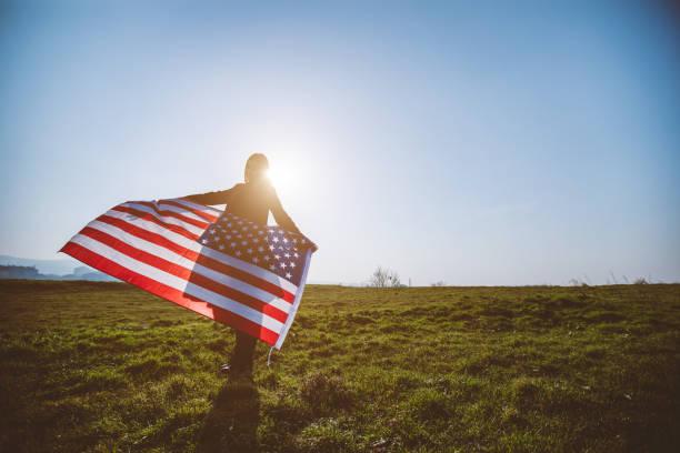 Woman waving USA flag stock photo