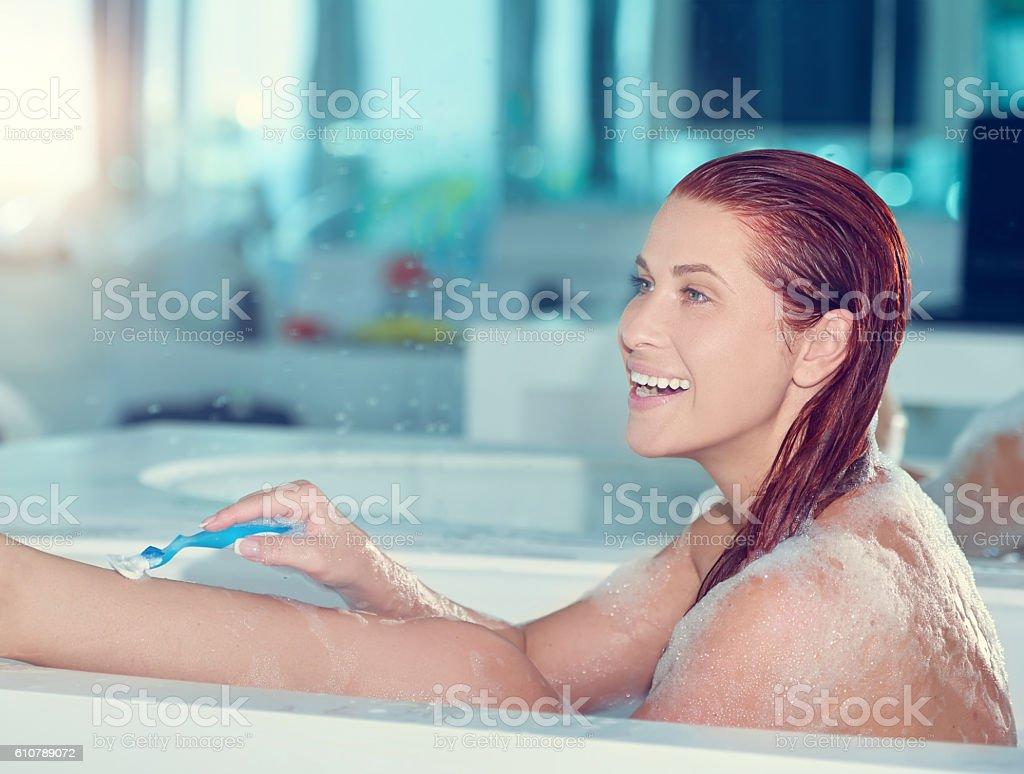 Redhead women in bathtub