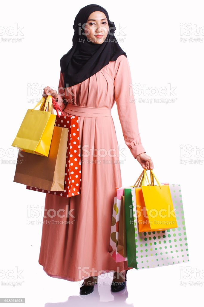 Woman wear a dress hold shopping bag enjoy buying items isolated on white background - shopping, consumer and lifestyle concept foto stock royalty-free