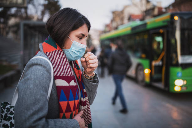Woman Wear Face Mask And Coughing While Standing In The Town