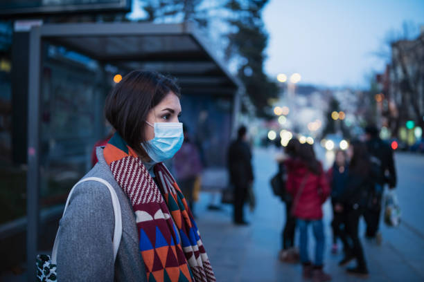 Woman Wear Face Mask And Waiting City Transport.
