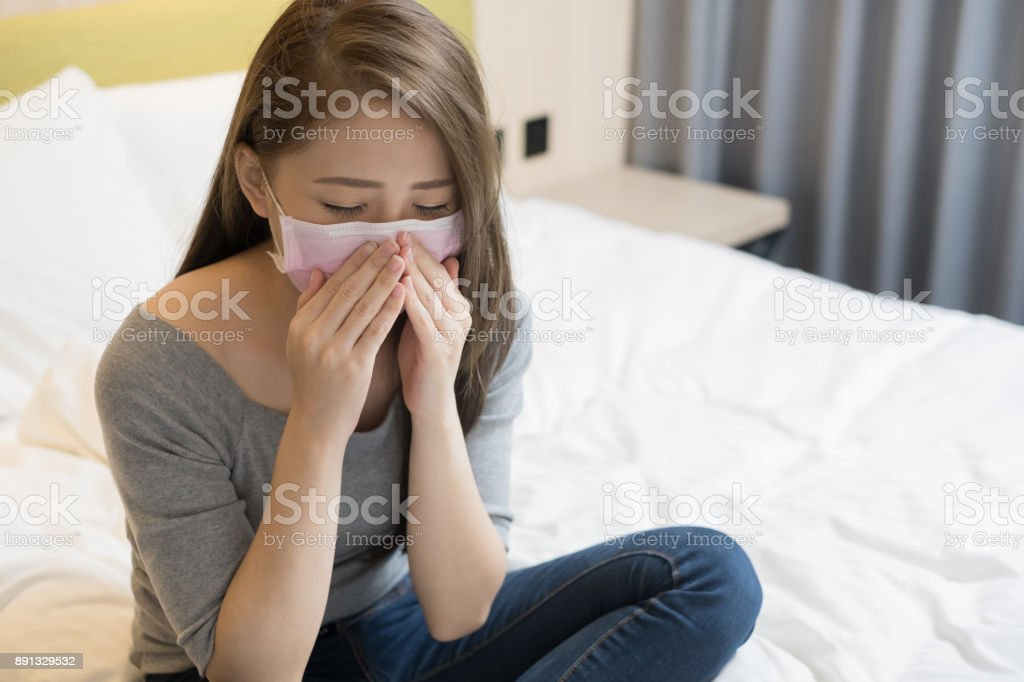 woman wear mask and coughing stock photo