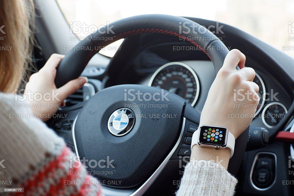 Woman wearing 38mm stainless steel Apple Watch stock photo