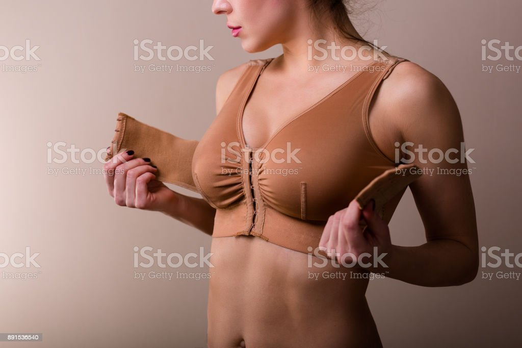 Woman wearing a compressing bra stock photo