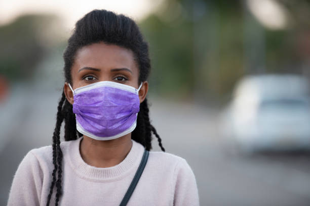 Woman wearing a face mask for the caution of coronavirus. stock photo