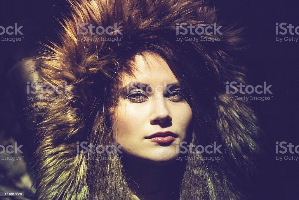 Woman wearing a furry hood royalty-free stock photo