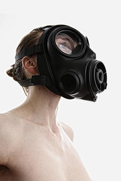 Woman wearing a gas mask stock photo
