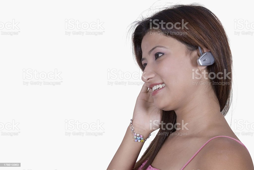 woman wearing a hands free device royalty-free stock photo