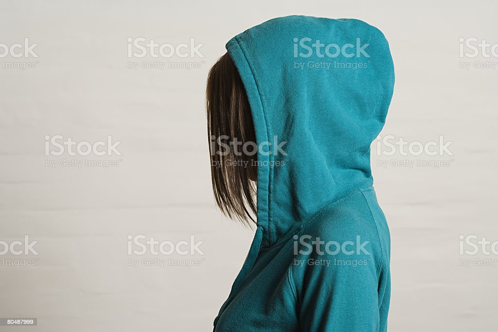 Woman wearing a hood royalty-free stock photo