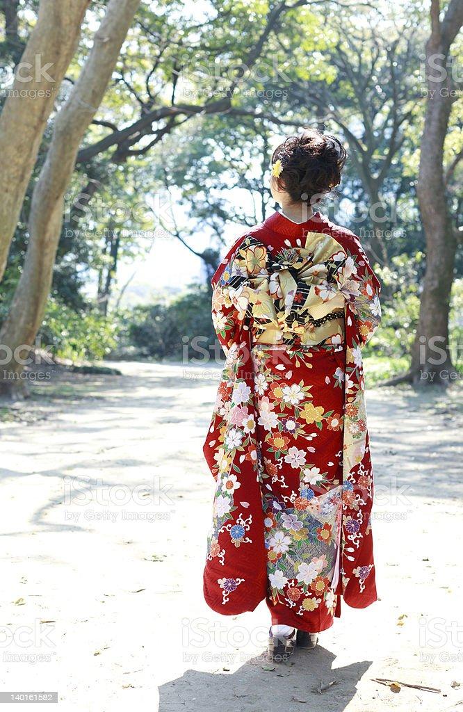 Woman wearing a kimono on a park stock photo