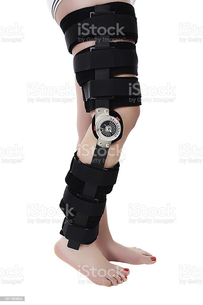 Woman wearing a leg brace stock photo