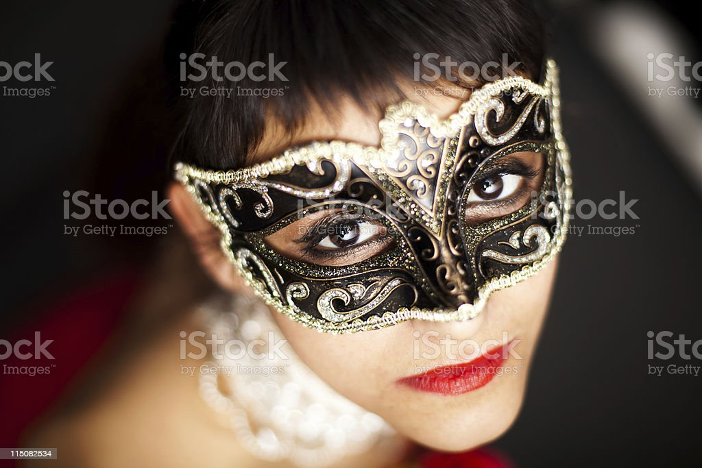 Woman wearing a  mask, looking up stock photo