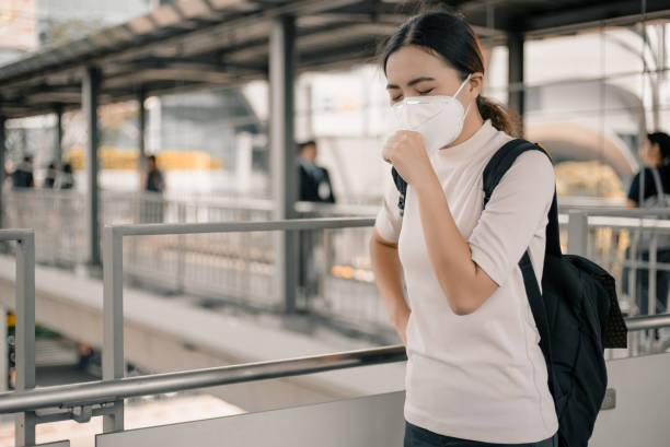 Woman wearing a mask stock photo